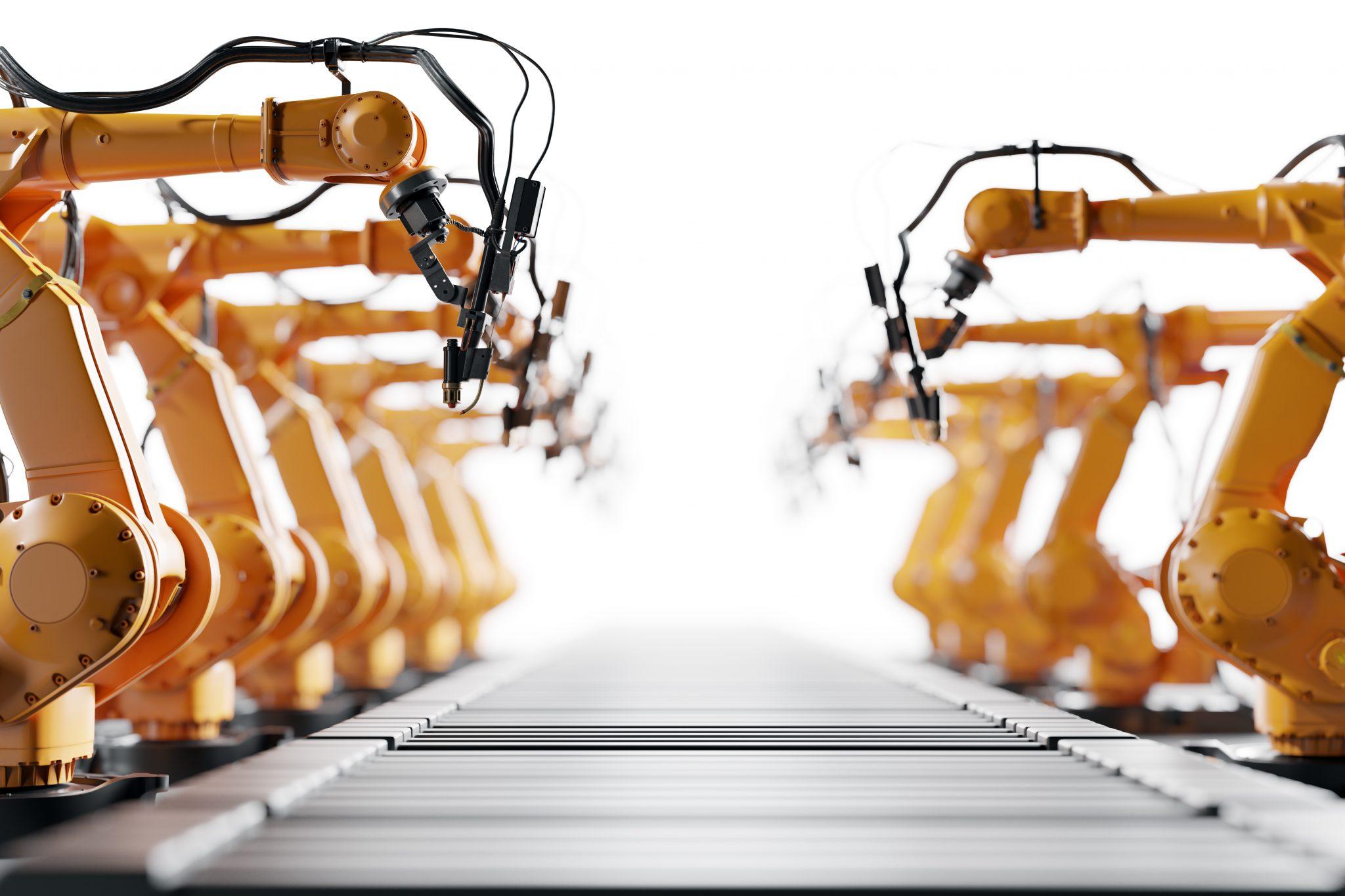 Teollisuusrobotteja rivissä.